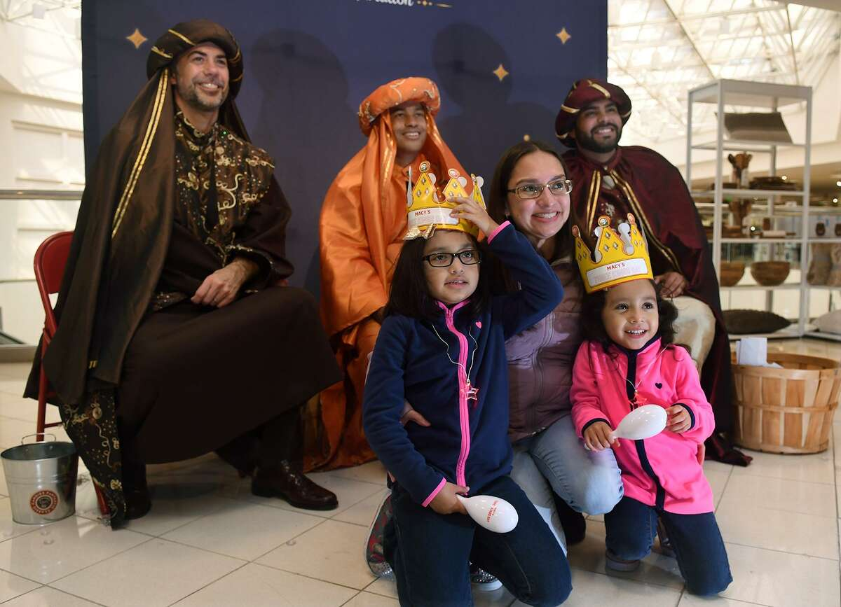 Nancy Acuna, front center, and her children Sophia, 7, left, a 2nd grader at Willbern Elem., and Melissa, 4, right, a Willbern Elem. pre-kindergartner, pose for a photo with the Three Kings, including