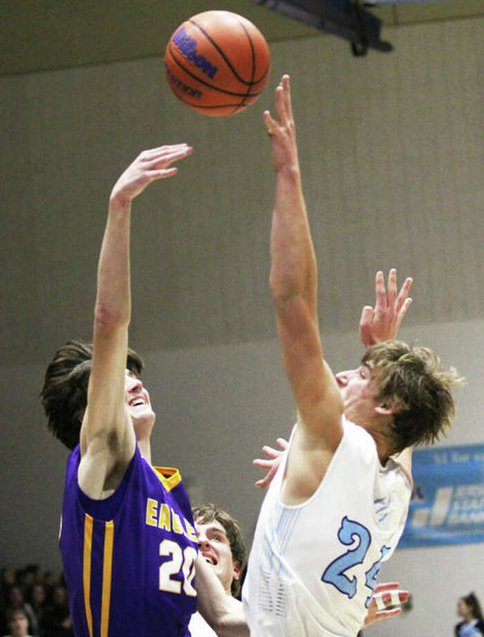 CM's Will Buhs (left) shoots over Jersey's Matthew Jackson during a MVC game Dec. 7 in Jerseyville. The Eagles were back on the road Tuesday and lost to Breese Central. Photo: Greg Shashack / The Telegraph