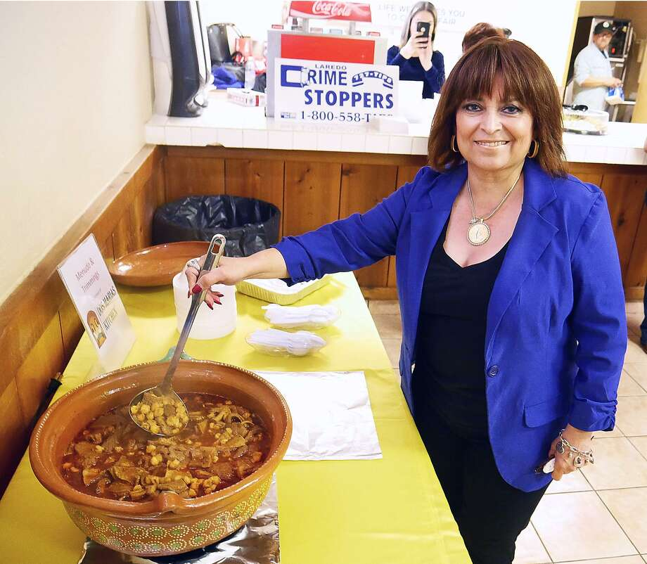 Linda Marie Martinez Payle, chairwoman for the Laredo Crime Stoppers 24th annual Menudo Bowl, stirs some of Dos Marias' menudo that was served at a news conference to announce details of the event. The Menudo Bowl is set to run from 10 a.m. to 7 p.m. Jan. 19 at LIFE Downs. All proceeds will benefit Laredo Crime Stoppers, a nonprofit organization. Photo: Cuate Santos /Laredo Morning Times / Laredo Morning Times