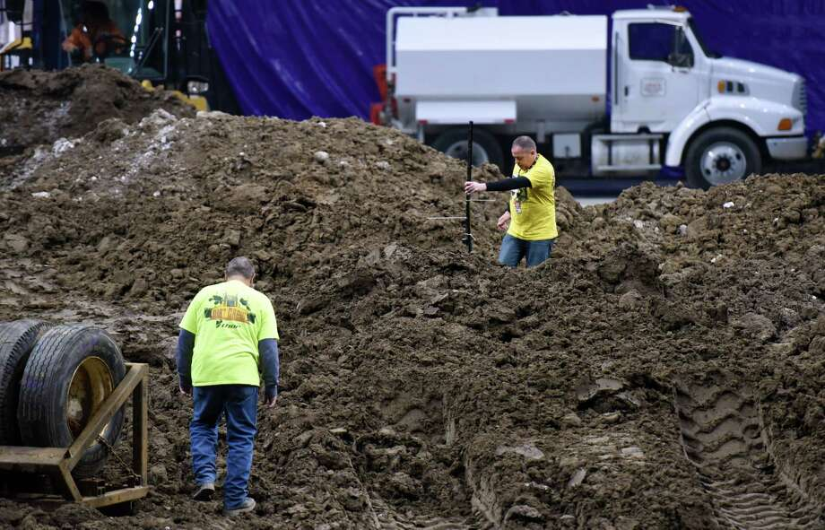 Shawn Arcaro, right, and Greg Grey work on track preparation for this weekend's Monster Jam event Wednesday, Jan. 9, 2019 at the Times Union Center in Albany, N.Y. (Phoebe Sheehan/Times Union) Photo: Phoebe Sheehan, Albany Times Union / 40045888A