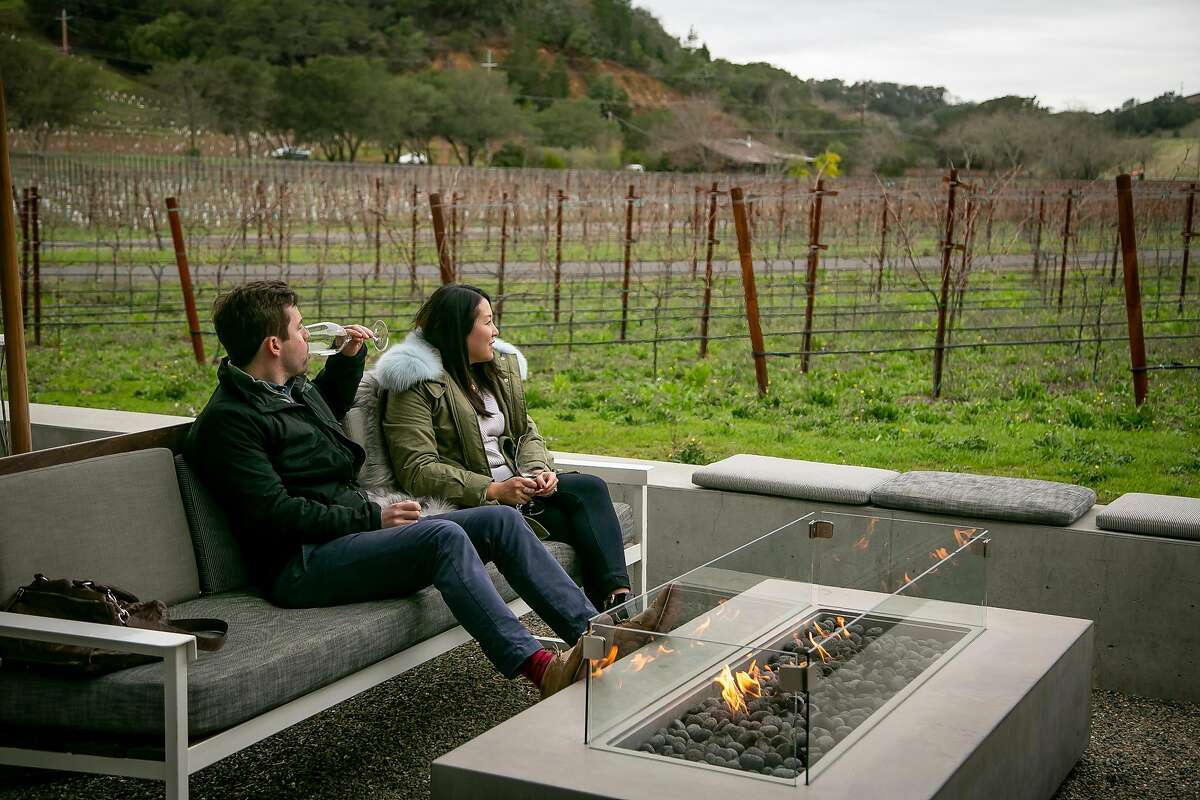 Chris and Allison Stanley enjoy a glass of wine on the patio at Odette Winery in Napa, Calif. on December 23rd, 2018.