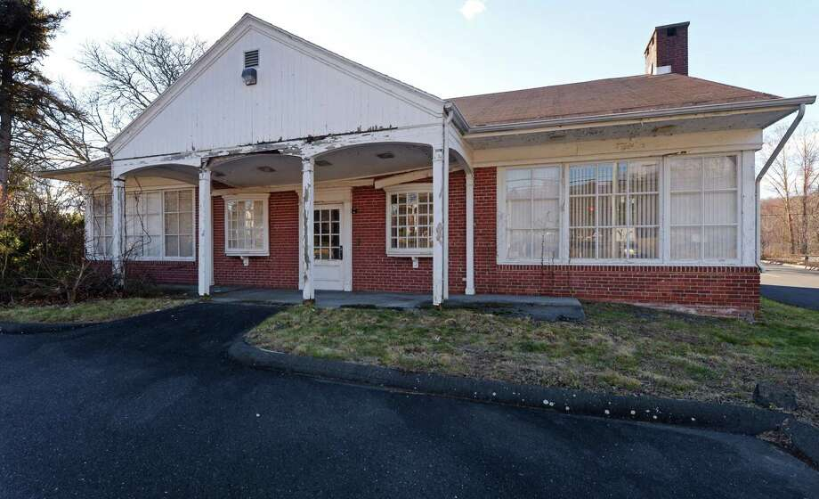 Vacant property at 241 Danbury Road Tuesday, DEcember 4, 2018, in Wilton, Conn. The Church of Jesus Christ of Latter-day Saints has filed for a regulation change to allow for a place of worship in a design retail business district. The church is hoping to construct a place of worship at a long vacant property across the street from Wilton Town Hall. Photo: Erik Trautmann / Hearst Connecticut Media / Norwalk Hour