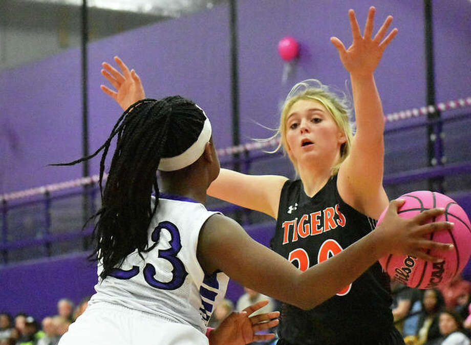 Edwardsville forward Morgan Hulme, right, plays defense against Collinsville in the first half on Tuesday in Collinsville. Photo: Matt Kamp/Intelligencer