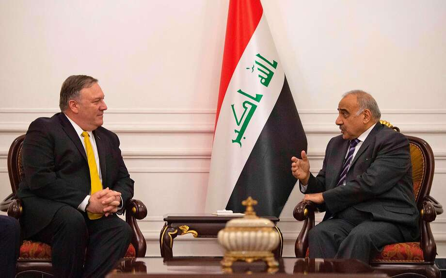 "Secretary of State Mike Pompeo (left) talks with Iraqi Prime Minister Adel Abdel-Mahdi. They discussed Iran and efforts to ensure the ""lasting defeat"" of the Islamic State. Photo: Andrew Caballero-Reynolds / AFP / Getty Images"