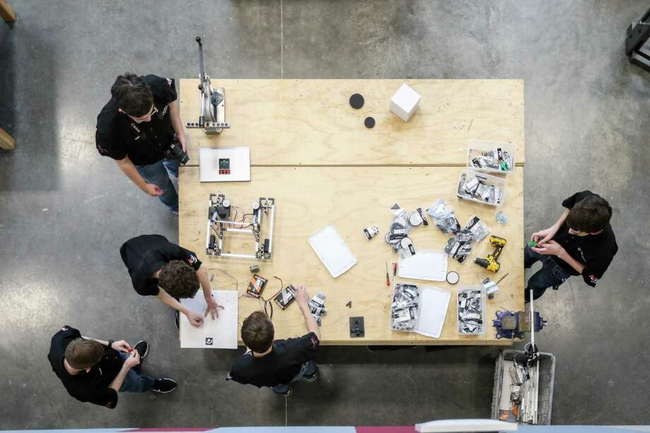 Members of College Park's Texas Torque Robotics Team have built a robot for Afghanistan's female robotics team, who lost their robot in transit to a competition in Mexico City, by reverse engineering the Afghani robot from a feature video. Photo: Michael Minasi, Staff Photographer / Houston Chronicle / © 2018 Houston Chronicle
