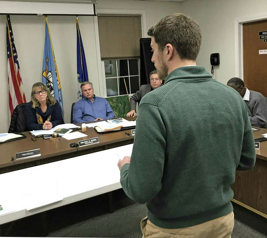 Jeremy DeCarli, East Hampton Planning and Zoning official, addresses Town Council members Tuesday night. Photo: Jeff Mill / Hearst Connecticut Media