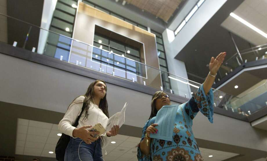 Collectively, Conroe ISD students consistently rank in the top few slots on STAAR exam results when compared to neighboring districts. In the data reported for last year, all Conroe ISD students in all subjects approaching grade level or above ranked third behind Katy and Montgomery ISD students. Here, Katherine Tugwell gets directions from school counselor Valeria Fuller as Grand Oaks High School opens its doors for the first time on Wednesday, Aug. 15, 2018, in Spring. Photo: Jason Fochtman, Staff Photographer / Staff Photographer / © 2018 Houston Chronicle