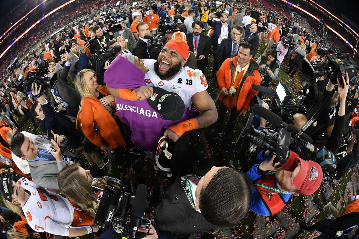 Clemson Tigers defensive tackle Christian Wilkins (42) celebrates with Houston Texans quarterback Deshaun Watson (purple hoodie) after the Clemson Tigers defeated the Alabama Crimson Tide in the College Football Playoff National Championship game on January 7, 2019, at Levi's Stadium in Santa Clara, CA. (Photo by Robin Alam/Icon Sportswire via Getty Images)