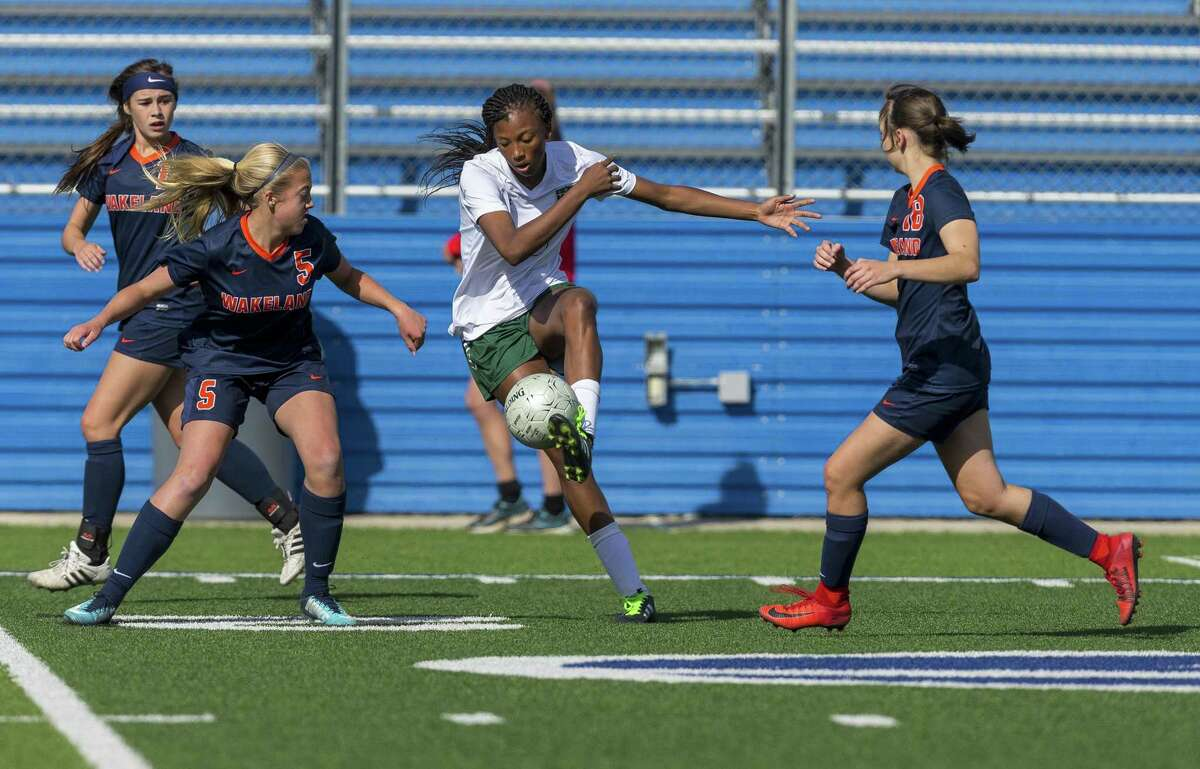 Humble Kingwood Park's Allie Byrd (18) looks to put the ball on the ground between Frisco Wakeland's Victoria Altieri, Abigail Strittmatter (5) and Hannah Mueller (18) during the Class 5A girls soccer state semifinal in Georgetown, Thursday, April 19, 2018. (Stephen Spillman)