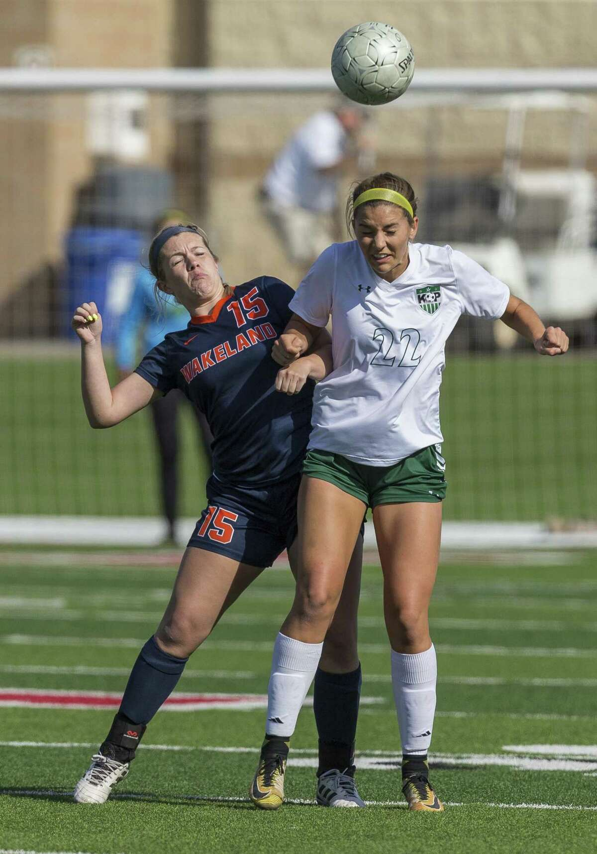 Frisco Wakeland's Avery Amador (15) and Humble Kingwood Park's Bailey Schoener (22) go for the header during the Class 5A girls soccer state semifinal in Georgetown, Thursday, April 19, 2018. (Stephen Spillman)