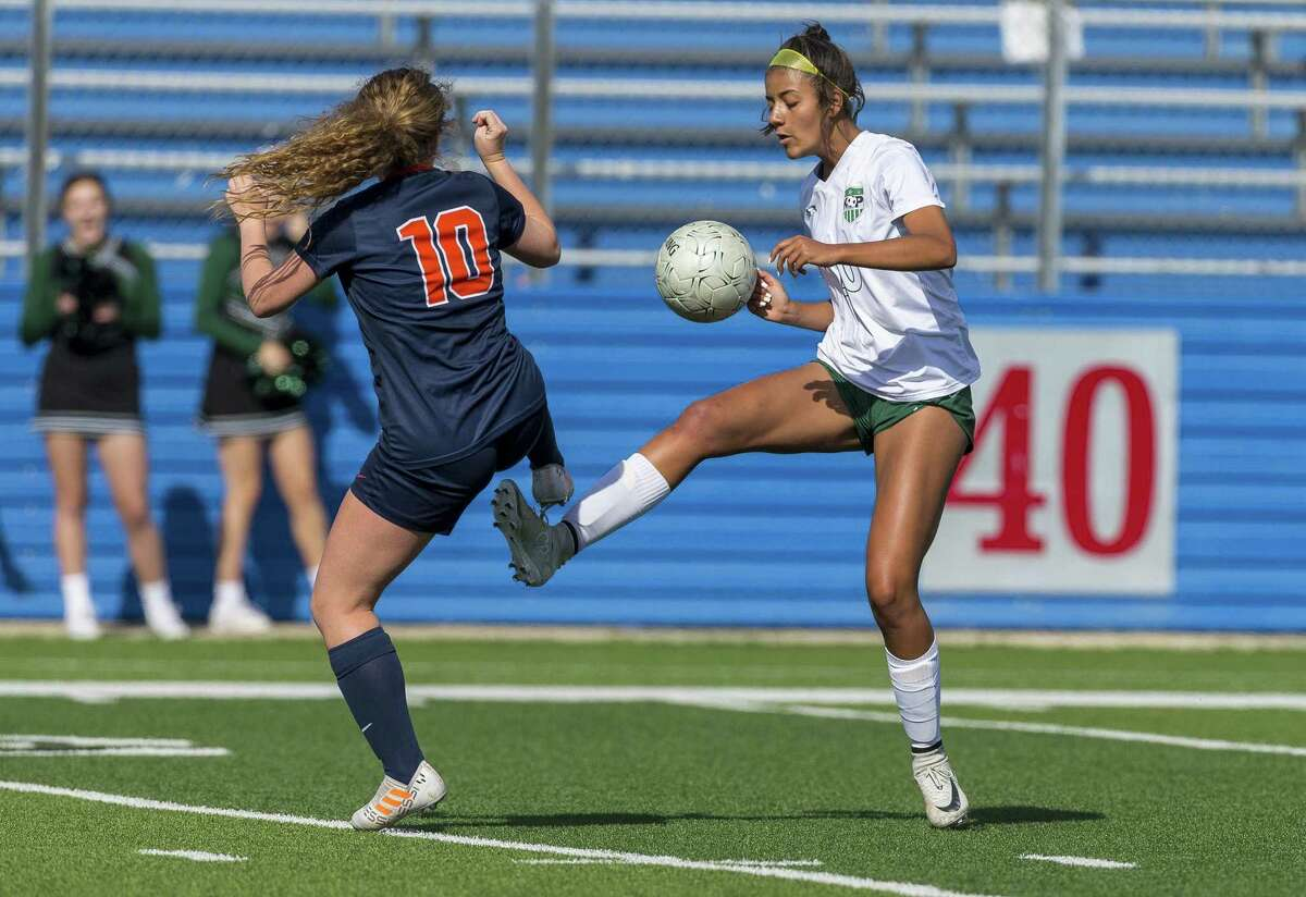 Humble Kingwood Park's Mia Wehby (20) and Frisco Wakeland's Taylor Fogle (10) battle for the ball during the Class 5A girls soccer state semifinal in Georgetown, Thursday, April 19, 2018. (Stephen Spillman)