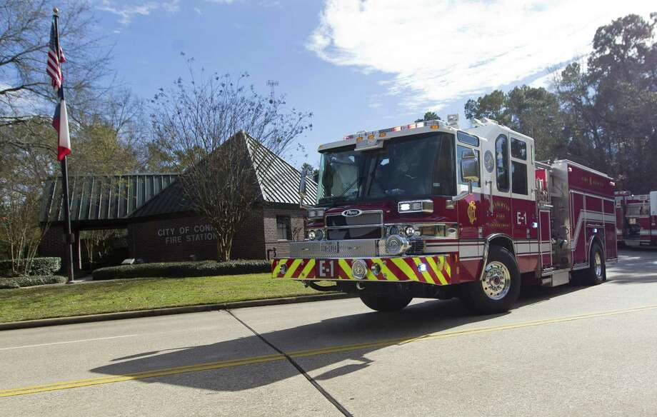 A firetruck with Station 1 leaves on a call, Thursday, Jan. 9, 2018, in Conroe. The Conroe Fire Department has begun phasing in an additional fourth firefighter per truck as part of the department's effort to increase personnel that began January 1. Photo: Jason Fochtman, Houston Chronicle / Staff Photographer / © 2018 Houston Chronicle