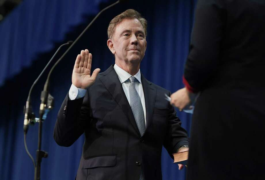 Connecticut Gov. Ned Lamont takes the oath of office administered by former Chief Justice Chase T. Rogers, Wednesday, Jan. 9, 2019, inside the William A. O'Neill Armory in Hartford Conn. (AP Photo/Jessica Hill, Pool) Photo: Jessica Hill / Associated Press / Copyright 2019 The Associated Press. All rights reserved