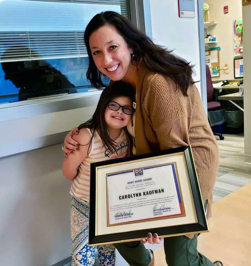 New Canaan YMCA Director of Special Needs Programming Carolynn Kaufman was presented with the Many Hands Award in the Constant Contributor category from the Down Syndrome Association of Connecticut in December. Photo: Contributed Photo
