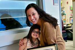 New Canaan YMCA Director of Special Needs Programming Carolynn Kaufman was presented with the Many Hands Award in the Constant Contributor category from the Down Syndrome Association of Connecticut in December.
