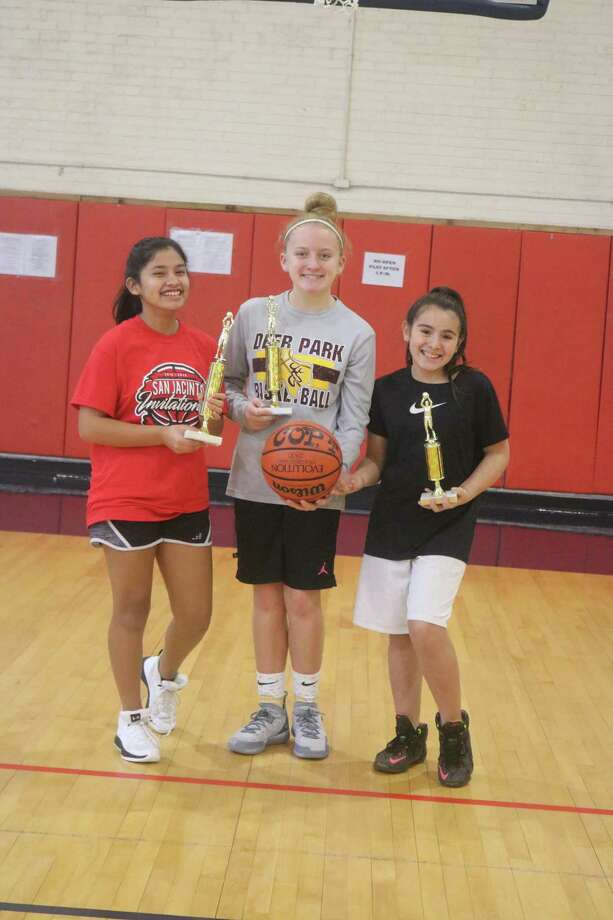 From L-R, the 11 and 12-year-old Super Swish trophy winners in the girls division are Valerie Zuniga, Kerbi Bowyer and Ariel Rodriguez. Photo: Robert Avery