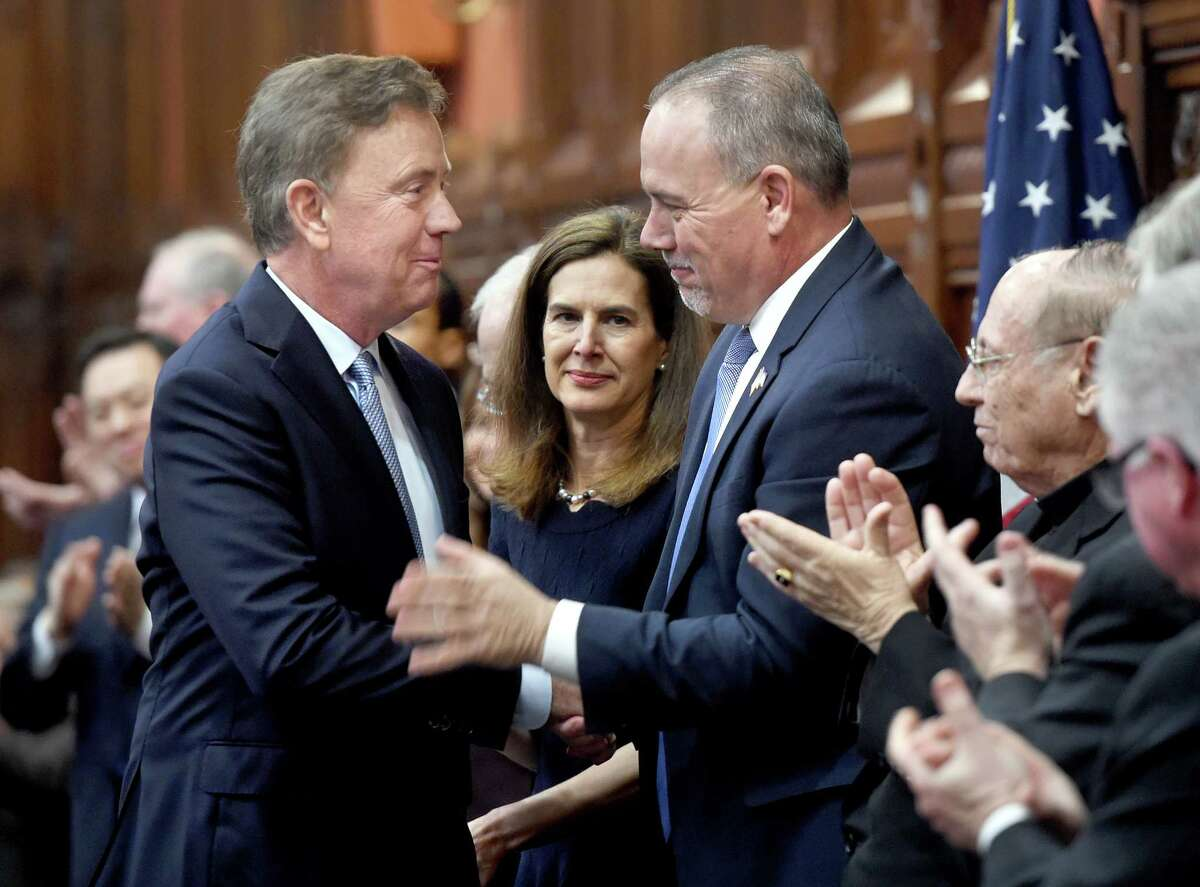 Governor Ned Lamont (left) shakes hands with Speaker of the House Joe Aresimowicz as he arrives to a joint session of the Connecticut General Assembly in Hartford to deliver the State of the State address on January 9, 2019.
