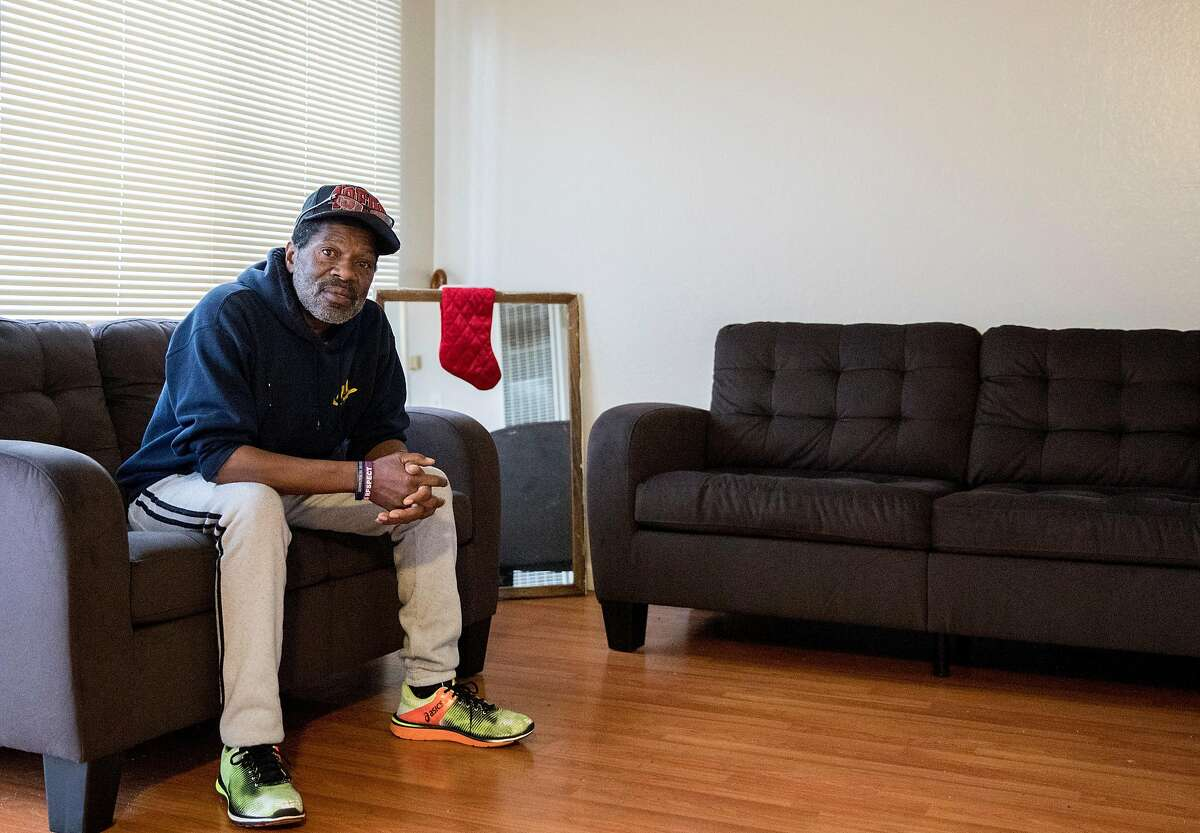 Marcus Emery, a formerly homeless man, poses for a portrait inside his new apartment in East Oakland, Calif. Tuesday, Jan. 8, 2019.