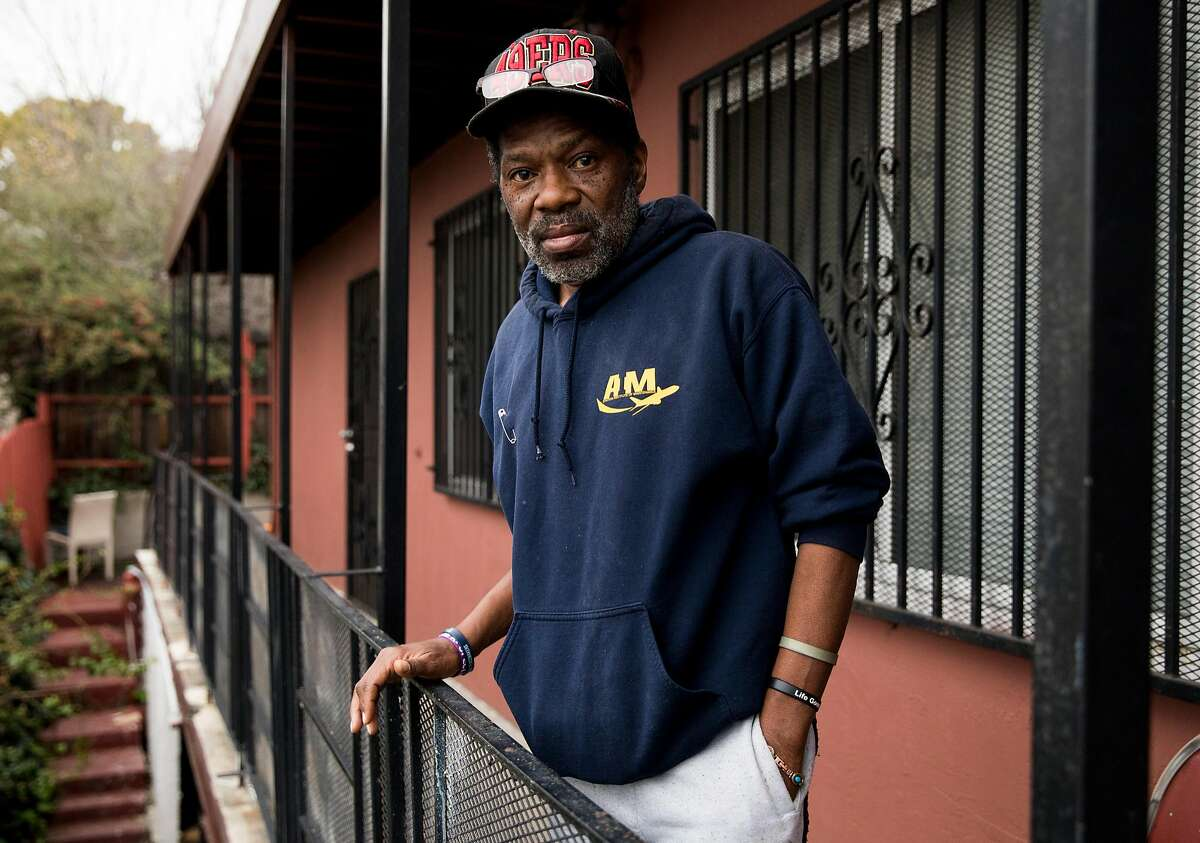 Marcus Emery, a formerly homeless man, poses for a portrait on the front porch of his new apartment in East Oakland, Calif. Tuesday, Jan. 8, 2019.