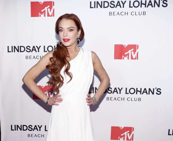 "NEW YORK, NY - JANUARY 07: Lindsay Lohan attends MTV's ""Lindsay Lohan's Beach Club"" Premiere Party at Moxy Times Square on January 7, 2019 in New York City. (Photo by Cindy Ord/Getty Images for MTV)"