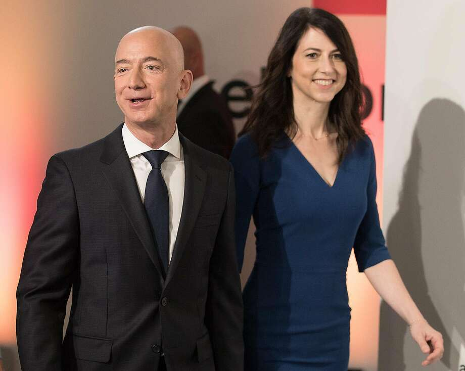 Amazon CEO Jeff Bezos and his wife MacKenzie Bezos arrive for the Axel Springer award ceremony on April 24, 2018. On Jan. 9, 2019, it was announced that Bezos and his wife will divorce after 25 years. (Jorge Carstensen/DPA/Zuma Press/TNS) Photo: Jorg Carstensen / Zuma Press 2018