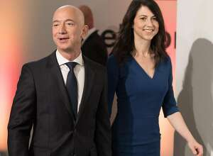Amazon CEO Jeff Bezos and his wife MacKenzie Bezos arrive for the Axel Springer award ceremony on April 24, 2018. On Jan. 9, 2019, it was announced that Bezos and his wife will divorce after 25 years. (Jorge Carstensen/DPA/Zuma Press/TNS)