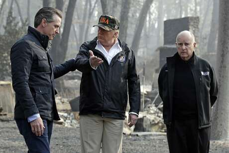 President Donald Trump talks with then Gov.-elect Gavin Newsom, as Gov. Jerry Brown listens during a visit to a neighborhood impacted by the Camp Fire in Paradise, on Nov. 17, 2018. Photo: Evan Vucci, Associated Press