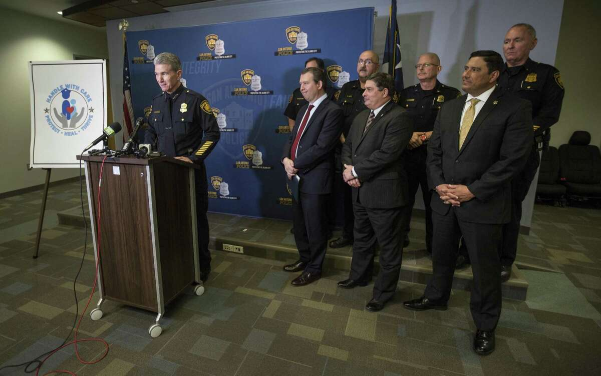 San Antonio Police Chief William McManus, left, speaks Wednesday, Jan. 9, 2018 at public safety headquarters about a new pilot program in which SAPD is partnering with San Antonio, East Central and North East ISDs. Police will notify schools if a child might have witnessed a traumatic event such as domestic violence, a fatal car wreck or a family member being arrested, so the school can watch for changes in the child's behavior and be prepared to help.