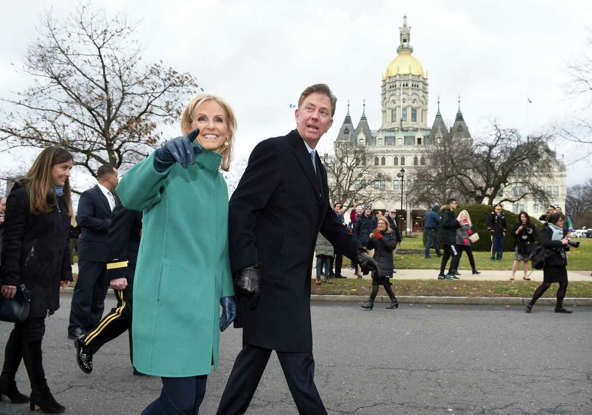 Governor Ned Lamont and his wife, Ann, walk in a parade outside of the Capitol Building in Hartford after he was sworn into office on January 9, 2019.