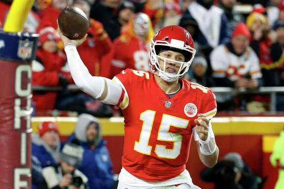 Kansas City Chiefs quarterback Patrick Mahomes (15) throws a touchdown pass to wide receiver Demarcus Robinson, unseen, during the second half of an NFL football game against the Oakland Raiders in Kansas City, Mo., Sunday, Dec. 30, 2018. With the throw, Patrick Mahomes joins Peyton Manning & Tom Brady as the only players with 50+ pass touchdowns in a single season in NFL history. (AP Photo/Charlie Riedel)