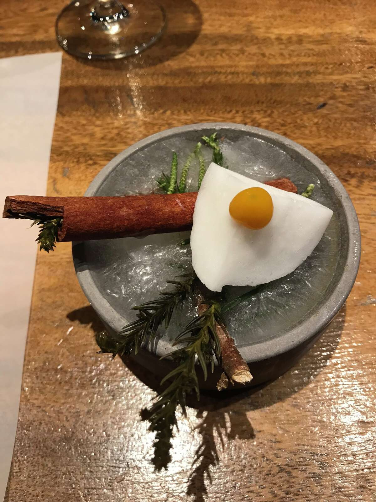 First up on the emoji list was the peach, but what landed in front of diners was a winter forest - branches and leaves jut out of a bowl of solid ice - and a frozen bite of food that was intensely white peach-flavored and melted as you chewed through it.