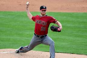 GLENDALE, AZ - MARCH 05: Shelby Miller #26 of the Arizona Diamondbacks delivers a pitch against the Los Angeles Dodgers in the second inning during the spring training game at Camelback Ranch on March 5, 2016 in Glendale, Arizona. (Photo by Jennifer Stewart/Getty Images)