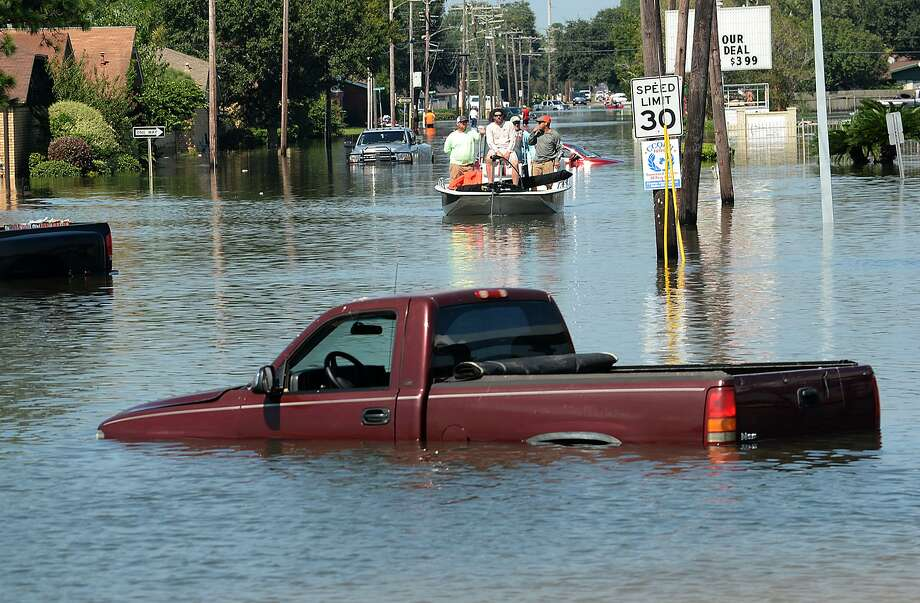 Port Arthur residents are boated through their flooded neighborhoods as volunteers and emergency crews continued to make rescues and assist residents Thursday.  Photo taken Thursday, August 31, 2017 Kim Brent/The Enterprise Photo: Kim Brent / Beaumont Enterprise / BEN