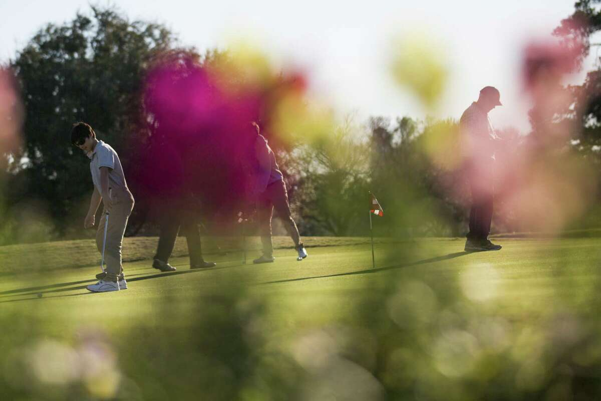 Golfers warm up and practice their shots on Wednesday at the at Memorial Park Golf Course, Jan. 9, 2019, in Houston.