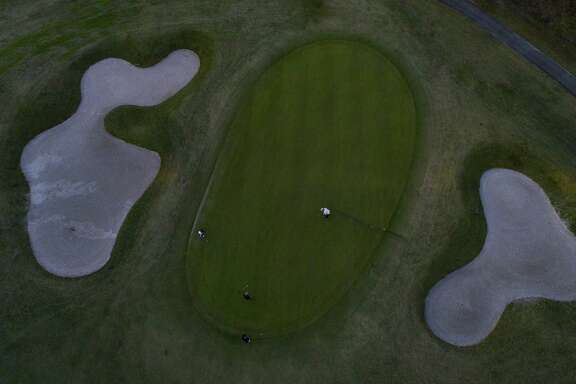 Golfers play their final rounds on the public golf course at Memorial Park in Houston, Wednesday, Jan. 9, 2019. The course will close for ten months beginning Thursday to begin renovations to make the course PGA-ready and a possible host for the Houston Open in 2020.
