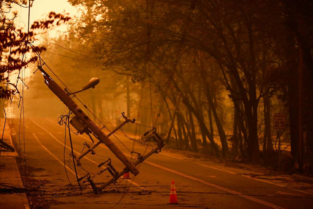A downed utility pole off of Elliott Road after the Camp Fire tore through the town of Paradise, California, on Friday, Nov. 9, 2018.
