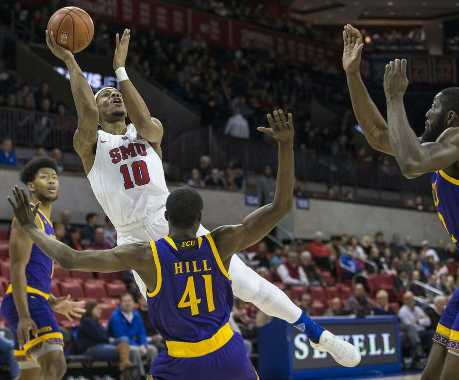 Southern Methodist's Jarrey Foster (10) goes up for a shot over East Carolina's Addison Hill (41) on Jan. 2 at Moody Coliseum in Dallas. Photo: Ryan Michalesko / TNS / Dallas Morning News