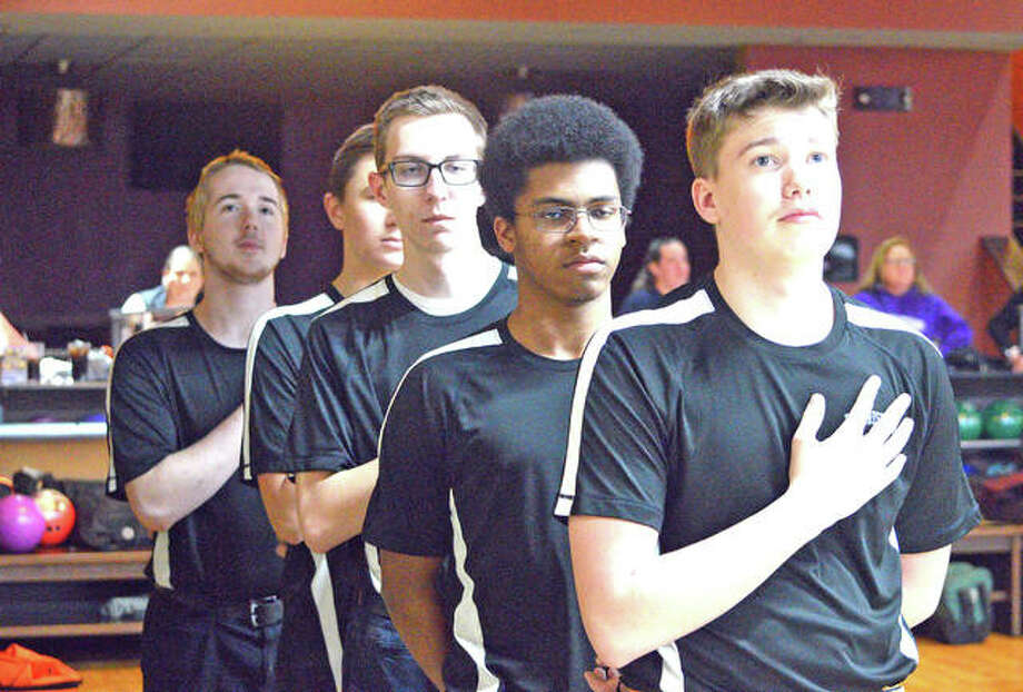The Edwardsville boys' bowling team lines up for the national anthem prior to Tuesday's Southwestern Conference match against Collinsville at Edison's Entertainment Center.