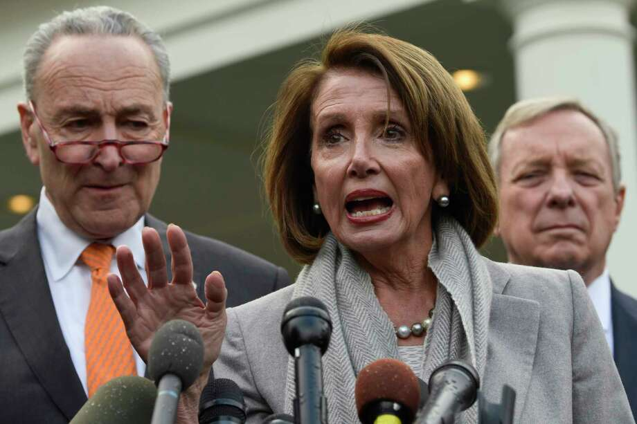 House Speaker Nancy Pelosi of Calif., center, speaks as she stands next to Senate Minority Leader Sen. Chuck Schumer of N.Y., left, and Sen. Dick Durbin, D-Ill., right, following their meeting with President Donald Trump at the White House in Washington, Wednesday, Jan. 9, 2019. Photo: Susan Walsh, AP / Copyright 2019 The Associated Press. All rights reserved.