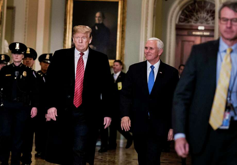 President Donald Trump and Vice President Mike Pence prepare to attend a Senate policy luncheon Wednesday on Capitol Hill, with the partial government shutdown in its 19th day. Photo: Washington Post Photo By Melina Mara / The Washington Post