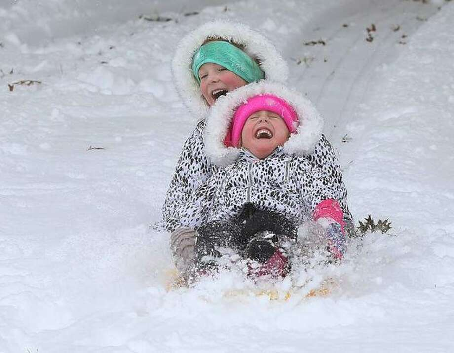 Children enjoy sledding in Alton's Haskell Park in mid-November after an unseasonably-early snow. Photo: John Badman | Hearst File Photo