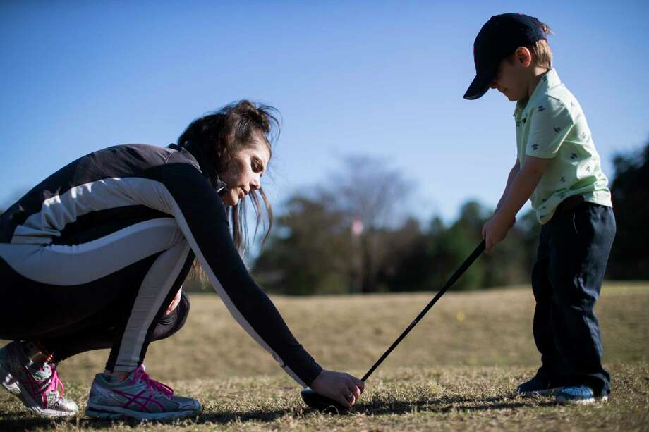 Mary Verbeck helps her son Landis Roccaforte, 3, learn the proper place where to hit a golf ball during a practice session at the Memorial Park Golf Course, Jan. 9, 2019, in Houston. Photo: Marie D. De Jesús, Staff Photographer / © 2019 Houston Chronicle