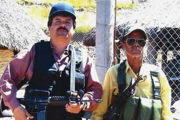"In this undated photo provided by the United States Attorney's Office for the Eastern District of New York, Joaquin ""El Chapo"" Guzman, left, poses with an unidentified man. Text messages sent by the Mexican drug lord known as El Chapo about narrowly avoiding capture in 2012 have become the latest damaging evidence at his U.S. trial. Prosecutors presented the texts Wednesday, Jan. 9, 2019 in federal court in Brooklyn, where Guzman has pleaded not guilty to drug-trafficking charges. (United States Attorney's Office for the Eastern District of New York)"