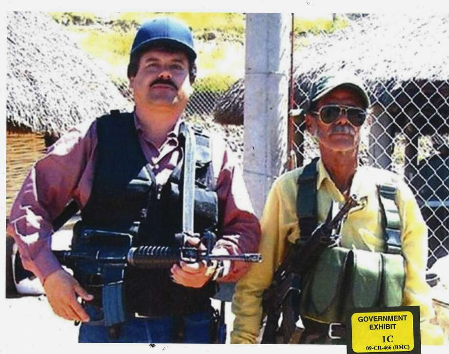 "In this undated photo provided by the United States Attorney's Office for the Eastern District of New York, Joaquin ""El Chapo"" Guzman, left, poses with an unidentified man. Text messages sent by the Mexican drug lord known as El Chapo about narrowly avoiding capture in 2012 have become the latest damaging evidence at his U.S. trial.  Prosecutors presented the texts Wednesday, Jan. 9, 2019 in federal court in Brooklyn, where Guzman has pleaded not guilty to drug-trafficking charges.  (United States Attorney's Office for the Eastern District of New York) Photo: Associated Press / US Attorney's Office for the Eastern District of New York"