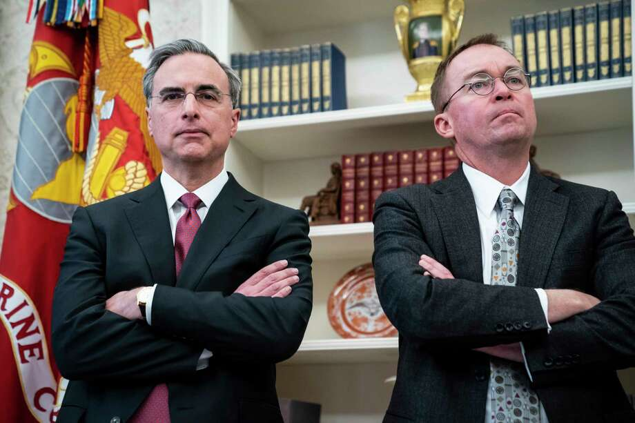 White House counsel Pat Cipollone, left, and Director of the Office of Management and Budget Mick Mulvaney, listen to an Oval Office meeting in December. Cipollone is building a legal team to promote President Donald Trump's executive privilege amid several investigations into his campaign and businesses. Photo: Washington Post Photo By Jabin Botsford. / The Washington Post