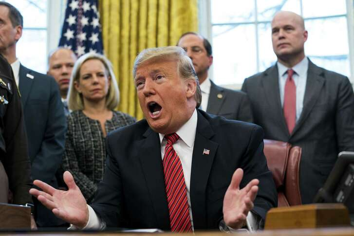 President Donald Trump at the signing ceremony for the Frederick Douglass Trafficking Victims Prevention and Protection Reauthorization Act, in the Oval Office of the White House, in Washington, Jan. 9, 2019. Wednesday also marked the 19th day of a partial government shutdown. Third from left is Homeland Security Secretary Kirstjen Nielsen, and at right is Acting Attorney General Matthew Whitaker. (Doug Mills/The New York Times)
