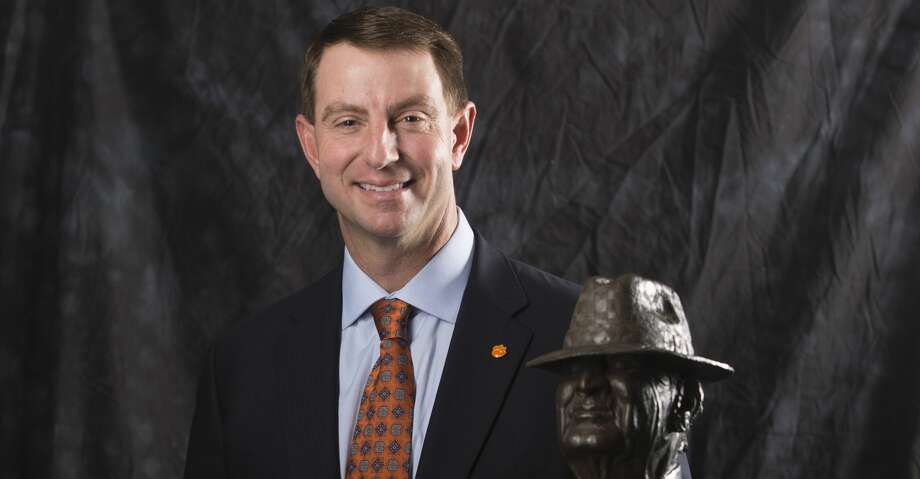 "Clemson coach Dabo Swinney poses for a photograph with the Paul ""Bear"" Bryant Coach of the Year Award, before the ceremony Wednesday, Jan. 9, 2019, in Houston. (Yi-Chin Lee/Houston Chronicle via AP) Photo: Yi-Chin Lee/Associated Press"