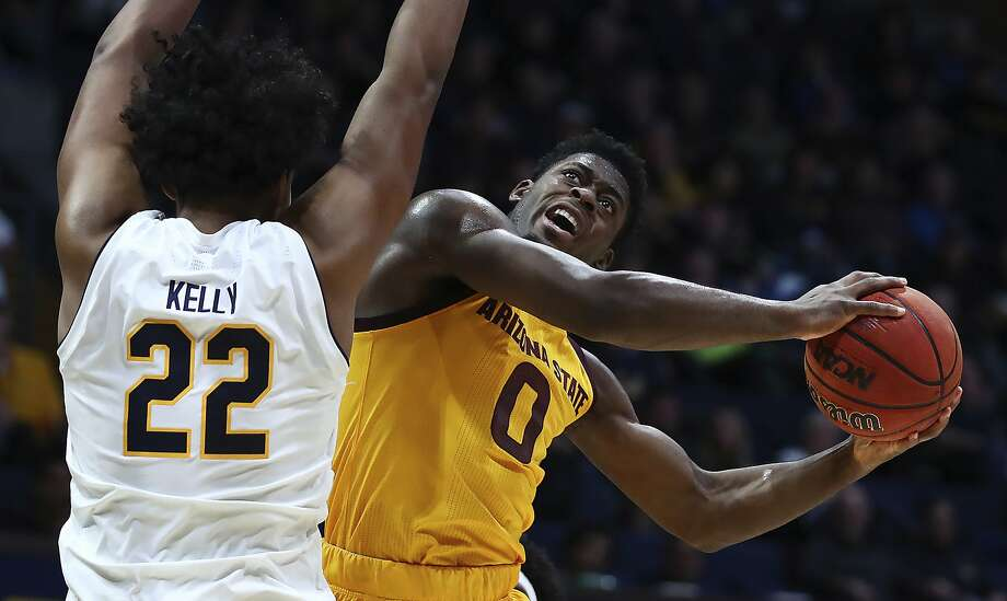 Arizona State guard Luguentz Dort, right, shoots as California's Andre Kelly defends during the first half of an NCAA college basketball game Wednesday, Jan. 9, 2019, in Berkeley, Calif. (AP Photo/Ben Margot) Photo: Ben Margot / Associated Press