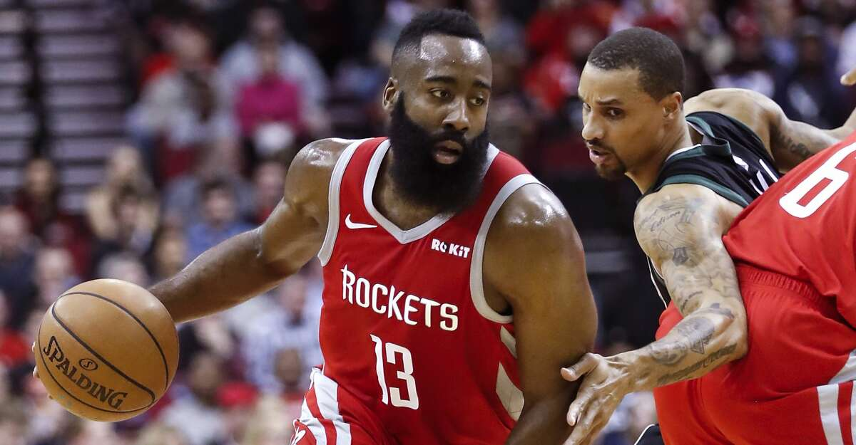Houston Rockets guard James Harden (13) takes the ball past a pick by forward Gary Clark (6) against the Milwaukee Bucks during the first half of an NBA basketball game at Toyota Center on Wednesday, Jan. 9, 2019, in Houston.