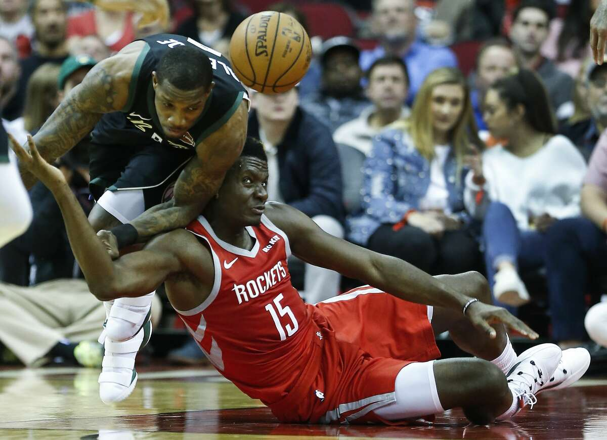 Houston Rockets center Clint Capela (15) and Houston Rockets forward Gary Clark (6) go after a loose ball on the floor during the first half of an NBA basketball game at Toyota Center on Wednesday, Jan. 9, 2019, in Houston.